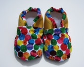 yellow, very hungry caterpillar baby booties