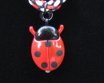 Ladybug Watch on a Red and Black Kumihimo Cord