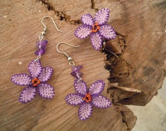 lilac flowershaped earrings and ring