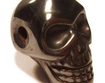 Skull Bead  - Carved Hematite   - 2mm hole ready to string - Indiana Jones Relic