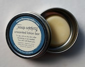 unscented solid lotion bar with travel tin