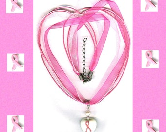 pink ribbon glass heart necklace on pink cord