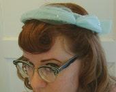 light blue net and rhinestone hat. 50s