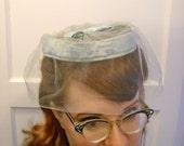 light blue veil hat