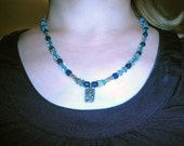 Blue crystals and beads w lotus flower charm necklace