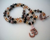 Copper, mocca, and topaz crystal Ohm necklace