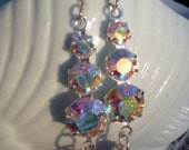 crystal earrings with light gold and fuschia dangles