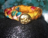 Printed Paisley silk  jersey braided bracelet with gold flower bead