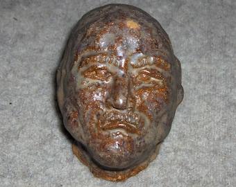 Careworn Face. Terracotta Sculptured Head with a wonderful Earthy Textured Glaze