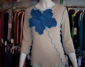 Oatmeal color top with blue rose decoraion and ruffled edging plus made in USA (v112)