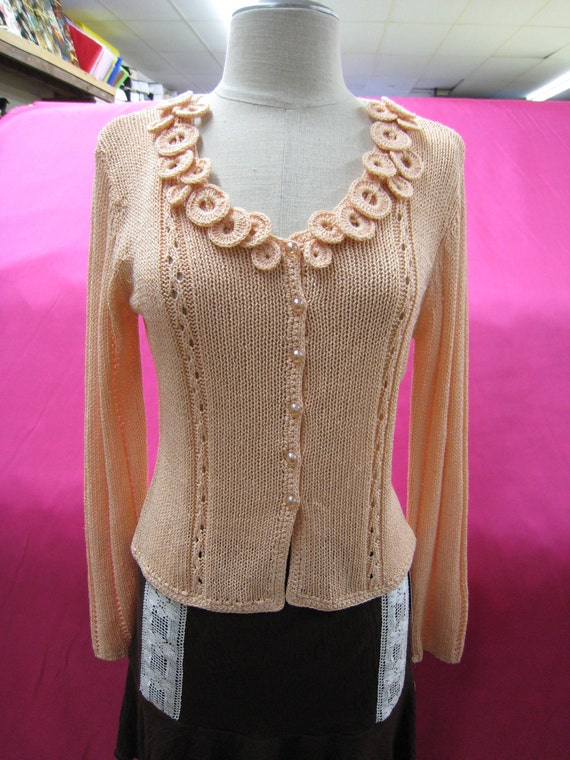 Peach color cardigan with buttons up front plus crochet floral decoraton (c27)