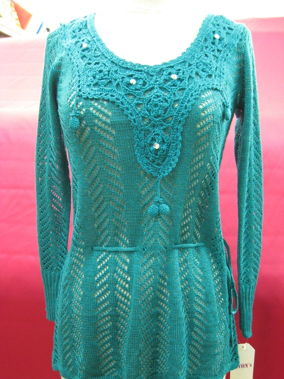 Turquoise color long sleeves sweater with clear acrylic decoration