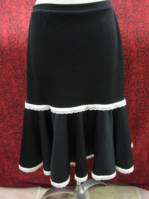 Black color knee length skirt with ivory color crochet trim plus made in USA