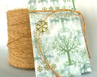 Tissue Paper. Winter Wonderland. Trees. Deer. Deer Stag. Snowflakes. Decorative. Printed. Sage Green. Gold. Silver. Nature. White Snow.
