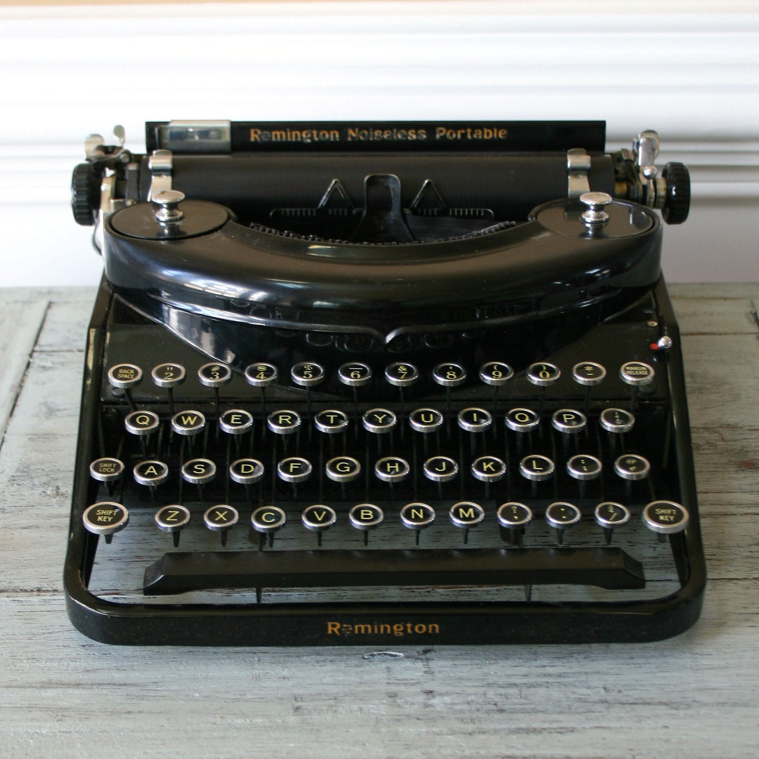 the noiseless typewriters Manufactured by the noiseless typewriter company of middletown, ct, this portable typewriter featured a three bank keyboard and a steel platen to reduce typing noise.