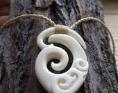Koru, Traditional hand carved Maori tribal bone pendant.