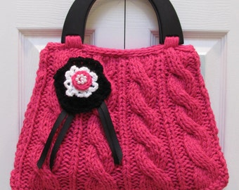 KNITTED  HANDBAG/PURSE,  Hot pink/raspberry, handknitted in a Designer style,black wood handles and a crocheted flower