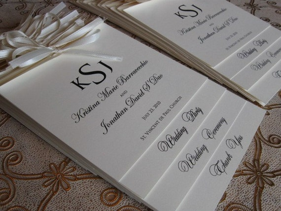 Monogram wedding ceremony programs tied with a ribbon on etsy