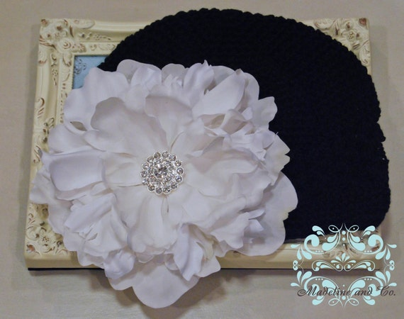 NEW ITEM...Large White Flower with Custom Made Rhinestones Cluster Center on Soft, Stretchy Black Beanie Hat. Fits Baby up to Young Girl.