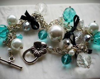Ribbon bracelet: chunky white pearls, aqua crystals and black bows (Sale)