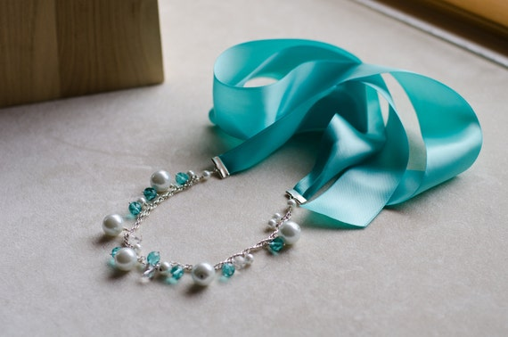 Chunky white pearl and teal ribbon necklace