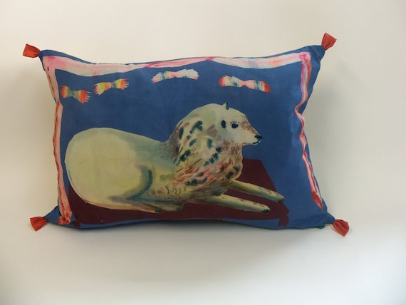 Large blue jazzy lion with curtain and poof. Its a silk cushion  or pillow