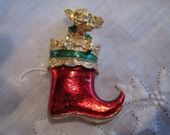 Vintage Gold Tone Red Christmas Stocking with a Poodle in it.