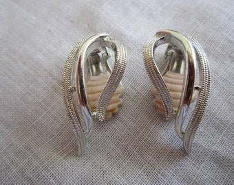 Vintage Silver Tone Curved Clip On Earrings by Sarah Coventry