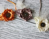 Spices of the Carribean- The Bella collection set of 3 shimmery silk flowers with feathers and vintage buttons