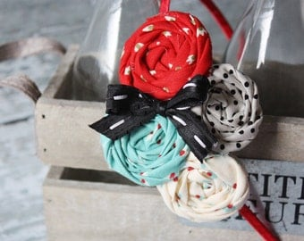 Marlo - red, aqua, ivory and black quadruple rosette headband