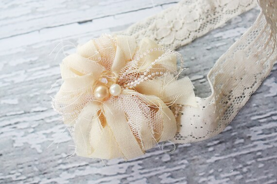 Bit of Vintage- frayed fabric flower on lace elastic with bead accents