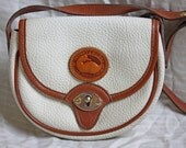 Dooney and Bourke Cream colored leather and tan leather trim petite Cross Body Shoulder Bag.