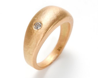 hand hammered 18K gold dome ring with a diamond