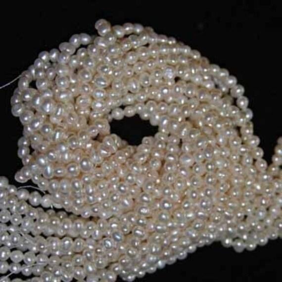 Freshwater Mini-Potato Ivory Pearls 4-5mm 16 inch strand