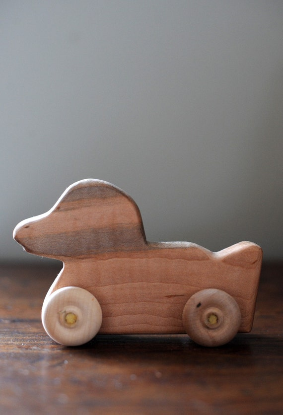 All natural wood duck on wheels in maple