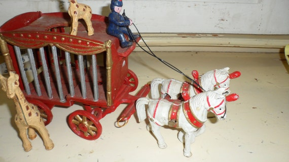 RESERVED JACQALOUIE  circus wagon metal with giraffes horses ad driver   the circus is in town metal wagon traveling circus