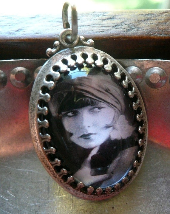 a young and very beautiful Louise Brooks...pendant with chain