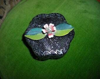 vintage black metal trinket box with flower