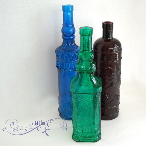 Price Reduced...vintage early 1960's set of 3 bottles - instant collection - dark turquoise - tealish green - purple
