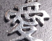 Sterling Charm That Is Marked Made In Hong Kong