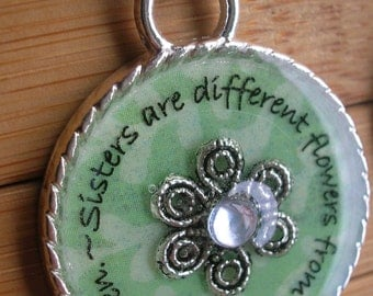 SALE Sisters are different flowers from the same garden... green and silver word quote pendant with chain