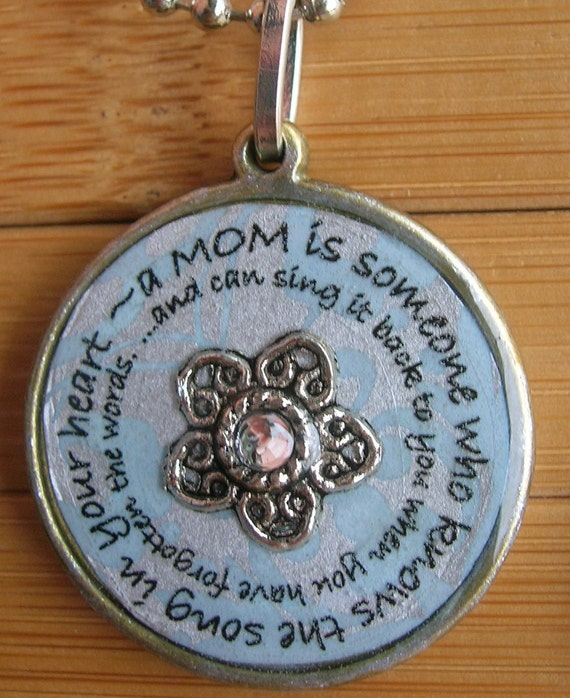 A mom is someone who knows the song in your heart and can sing it back to you when you have forgotten the words...silver pendant with chain