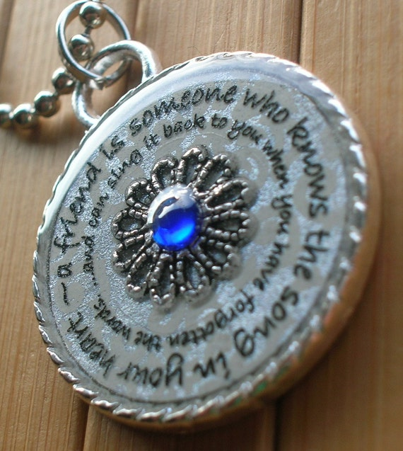 A friend is someone who knows the song in your heart and can sing it back to you when you have forgotten the words...silver pendant