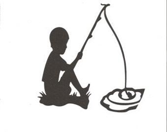 Little boy fishing  silhouette