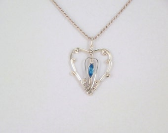 Faceted Swiss Blue Argentium Sterling Silver Wire Wrap Pendant