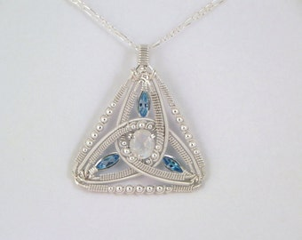 Faceted rainbow moonstone and swiss blue topaz sterling argentium silver wire wrap pendant