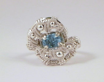 Faceted swiss blue topaz and sterling argentium silver wire wrap ring