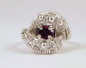 Faceted garnet and sterling argentium silver wire wrap ring