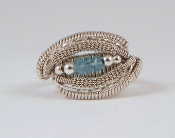 Micro faceted swiss blue topaz and sterling argentium silver wire wrap ring