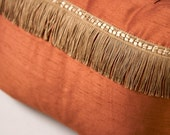 Silk Rust pillow with golden fringe